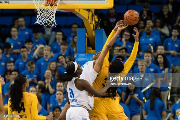 California Golden Bears center CJ West and UCLA Bruins forward Monique Billings go up for a rebound during the game between the Cal Berkeley Golden...