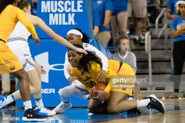 California Golden Bears center CJ West and UCLA Bruins guard Japreece Dean fight over a loose ball during the game between the Cal Berkeley Golden...