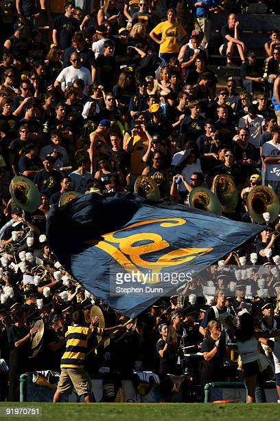 California Golden Bears cheerleader waves a flag in front of the Cal band and visitor's section in the game with the UCLA Bruins on October 17 2009...