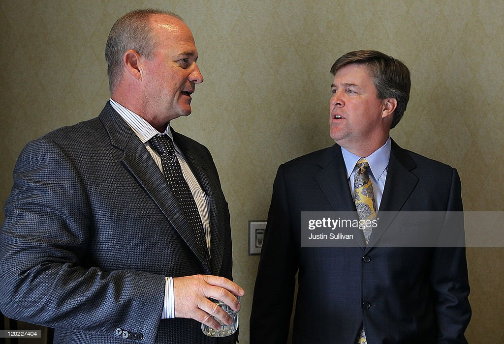 California Golden Bears football coach Jeff Tedford (L) talks with San Jose State football coach Mike MacIntyre during the Bay Area college football media day at the Hotel Nikko on August 1, 2011 in San Francisco, California. Players and coaches from Stanford, Cal and San Jose State football programs met with reporters ahead of the new season during Bay Area college football media day.