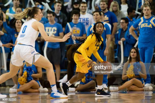 California Golden Bears guard Asha Thomas dribbles the ball to the outside during the game between the Cal Berkeley Golden Bears and the UCLA Bruins...