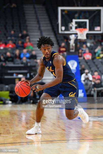 California Golden Bears guard Joel Brown looks to make a pass during the first round game of the men's Pac12 Tournament between the Stanford Cardinal...