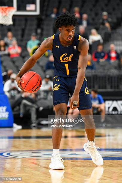 California Golden Bears guard Joel Brown sets up the offense during the first round game of the men's Pac-12 Tournament between the Stanford Cardinal...
