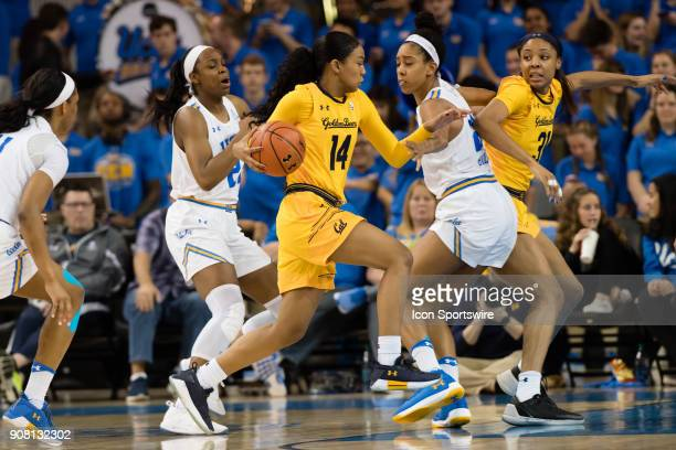 California Golden Bears guard Kianna Smith drives to the basket with UCLA Bruins forward Monique Billings and UCLA Bruins guard Kennedy Burke...