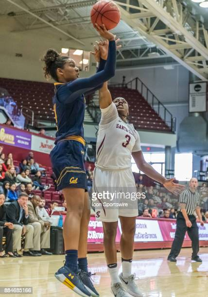 California Golden Bears guard Kianna Smith jumps up for a shot with Santa Clara Broncos guard Taylor Berry trying to block during the game between...