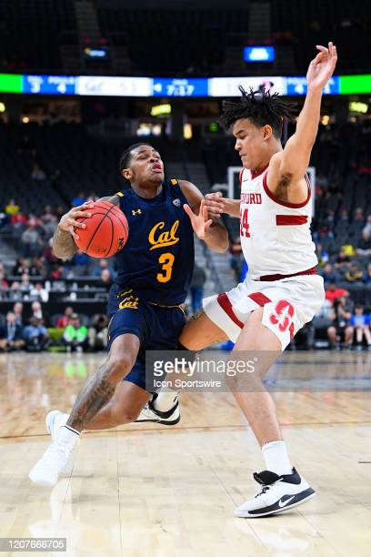 California Golden Bears guard Paris Austin drives to the basket guarded by Stanford Cardinal forward Spencer Jones during the first round game of the...