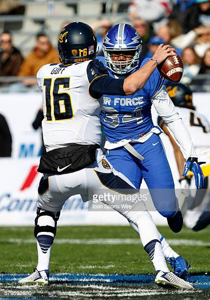California Golden Bears quarterback Jared Goff is pressured by Air Force Falcons linebacker D.J. Dunn Jr. During the Lockheed Martin Armed Forces...