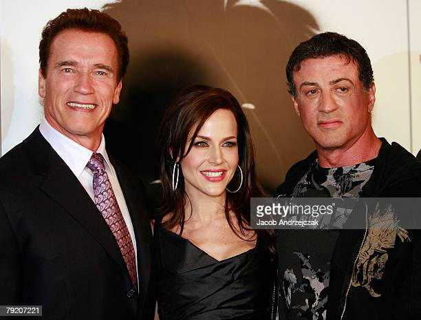 California Gov Arnold Schwarzenegger actress Julie Benz and actor Sylvester Stallone arrive at the world premiere of the movie 'Rambo' at the Planet...