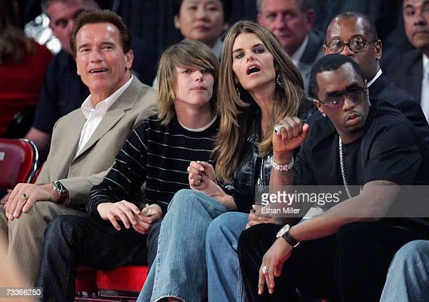 California Gov Arnold Schwarzenegger his son Patrick Schwarzenegger television personality Maria Shriver and music artist Diddy watch the 2007 NBA...