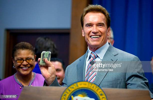 California Gov Arnold Schwarzenegger holds up his money clip when asked if he was worried that the state would run out of money if the state budget...
