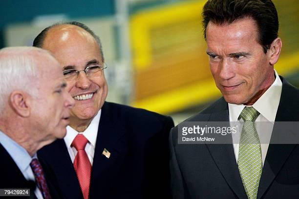 California Gov Arnold Schwarzenegger listens after endorsing Republican presidential hopeful US Sen John McCain as former New York City Mayor...