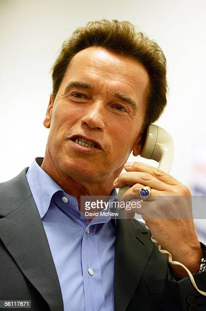 California Gov Arnold Schwarzenegger makes a getoutthevote phone call during a campaign stop at the Corona Republican Party headquarters on the eve...