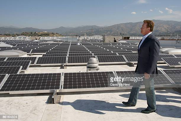 California Gov Arnold Schwarzenegger tours a solar panel installation on the roof of a Sam's Club store on Earth Day April 22 2009 in Glendora...