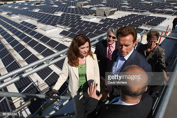 California Gov Arnold Schwarzenegger WalMart vice president and California regional general manager Kimberly Sentovich and Executive Director of the...