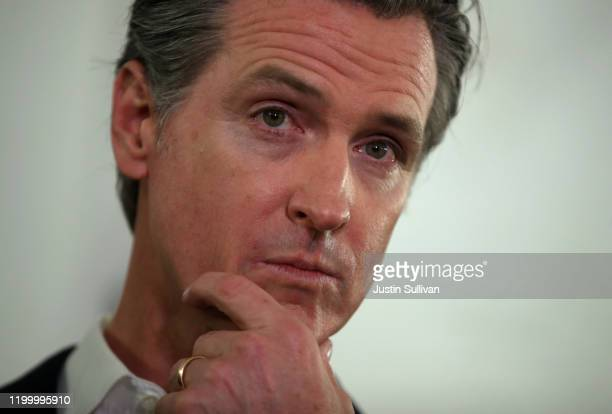 California Gov Gavin Newsom looks on during a a news conference about the state's efforts on the homelessness crisis on January 16 2020 in Oakland...