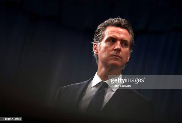 California Gov Gavin Newsom looks on during a news conference with California attorney General Xavier Becerra at the California State Capitol on...