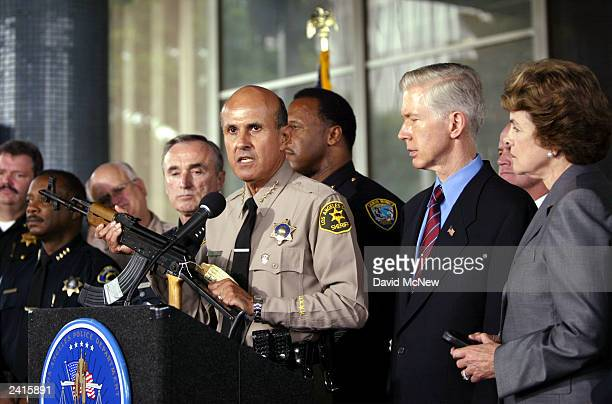 California Gov Gray Davis and Sen Dianne Feinstein DCalifornia look on as Los Angeles County Sheriff Lee Baca holds a Chinesemade AK47 assault rifle...