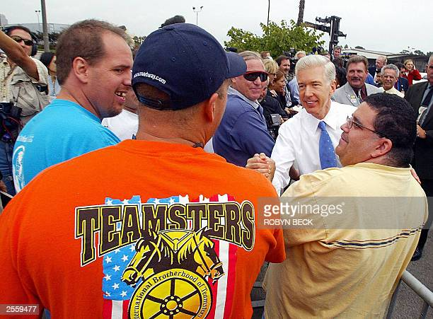 California Gov Gray Davis greets Teamsters union members and truck driver Gary Delahunty as he leaves a No on the Recall rally at the Port of Long...