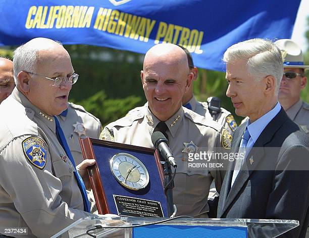 California Gov. Gray Davis receives a plaque from the California Highway Patrol in honor of his role in the creation and implementation of the...
