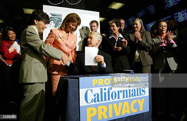 California Gov. Gray Davis signs a financial privacy bill at the Pacific Stock Exchange August 27, 2003 in San Francisco, California. Davis, who is...