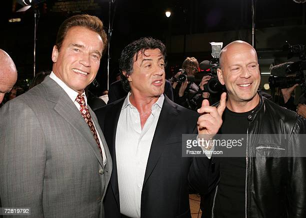 California governor Arnold Schwarzenegger actor Sylvester Stallone and actor Bruce Willis arrive at the premiere of MGM's Rocky Balboa at the...