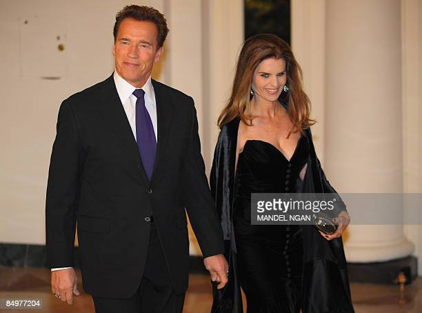 California Governor Arnold Schwarzenegger and his wife Maria Shriver arrive at the Book Seller�s Entrance February 22, 2009 at the White House for...