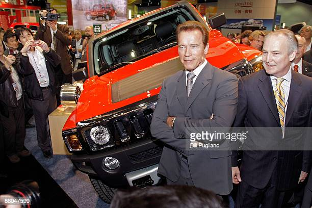 California Governor Arnold Schwarzenegger and Raser Technologies Chairman Kraig Higginson pose with the new Hummer H3 the first full electric drive...