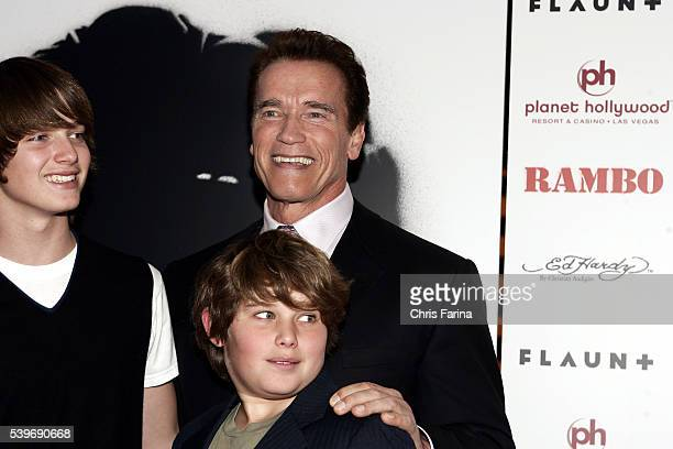 California Governor Arnold Schwarzenegger and sons Patrick and Christopher arrive at the world premiere of the movie 'Rambo' held at the Planet...
