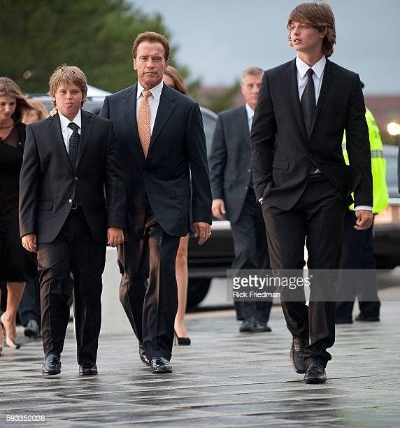 California Governor Arnold Schwarzenegger arriving at the memorial for Senator Edward M Kennedy with his sons Patrick and Christopher at the John F...
