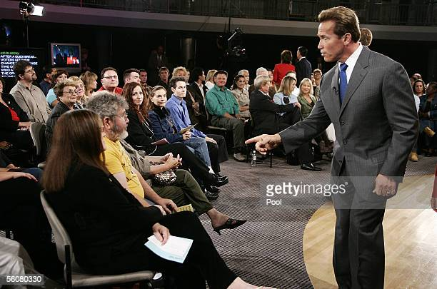 California Governor Arnold Schwarzenegger gestures as he answers questions regarding Propositions 74 through 77 of next week's Special Election from...