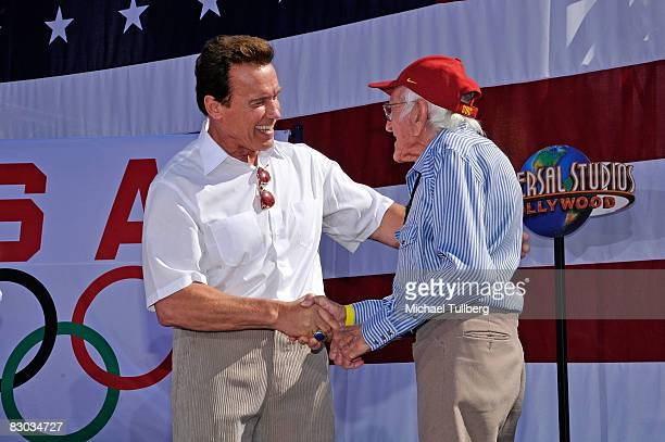 California Governor Arnold Schwarzenegger greets 1936 Olympian Louis Zamperini at a ceremony honoring California Olympians and Paralympians held at...
