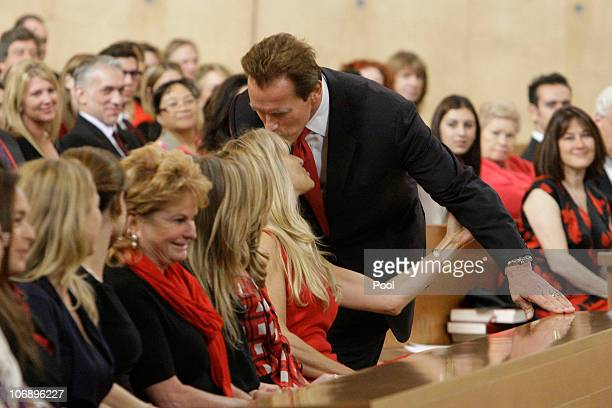 California Governor Arnold Schwarzenegger kisses Martha De Laurentiis wife of Italian film mogul and Hollywood producer Dino De Laurentiis during the...
