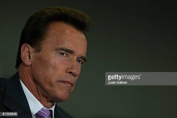 California governor Arnold Schwarzenegger looks on as presumptive Republican presidential candidate US Sen John McCain speaks during a Global...