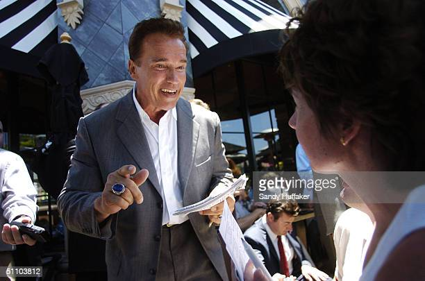 California Governor Arnold Schwarzenegger meets with restaurant patrons at the Cheesecake Factory July 21 2004 in San Diego California Governor...