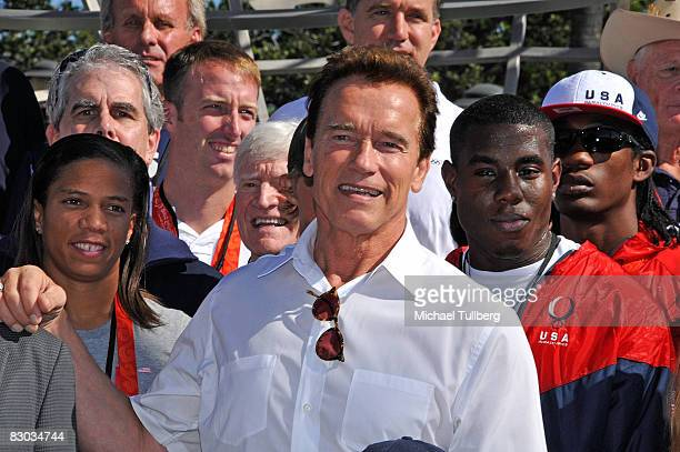 California Governor Arnold Schwarzenegger poses with California Olympians and Paralympians prior to a ceremony honoring California Olympians and...