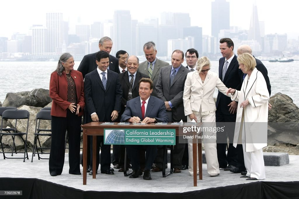 California Governor Arnold Schwarzenegger (C) signs landmark legislation bill AB-32, the California Global Warming Solutions Act of 2006 to reduce greenhouse emissions in order to help global warming on September 27, 2006 on Treasure Island in San Francisco, California. Schwarzenegger was joined by New York Governor George Pataki, and British Prime Minister Tony Blair via satellite along with other international leaders with a consistent record of addressing the global threat of climate change and other environmental and industry leaders.