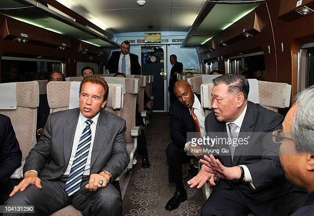 California Governor Arnold Schwarzenegger sits with President of Hyundai Motor Co Chung MongKoo during an inspection of South Korea's highspeed train...