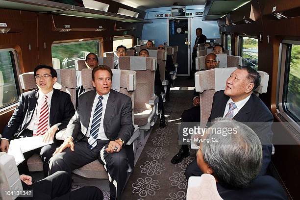 California Governor Arnold Schwarzenegger sits with President of Hyundai Motor Co Chung MongKoo and Sim HyeogYun vice president of Korea Railroad...