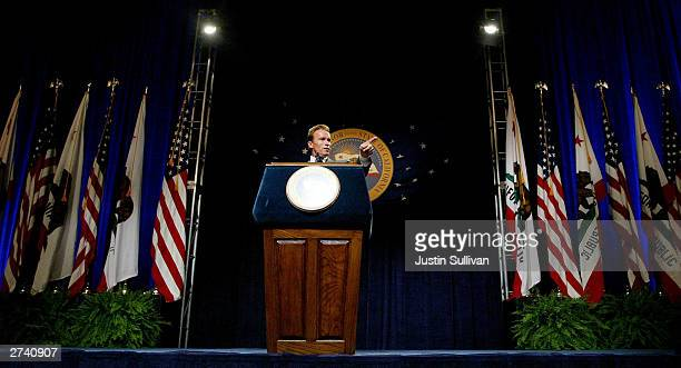 California Governor Arnold Schwarzenegger speaks to reporters during his first news conference as governor November 18 2003 in Sacramento California...