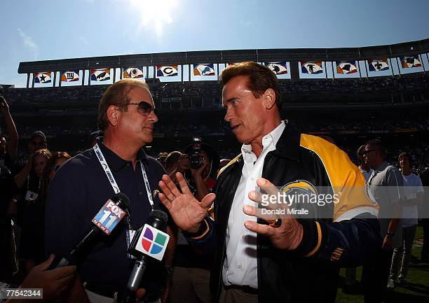 California Governor Arnold Schwarzenegger speaks with San Diego Charger Owner Dean Spanos before the start of the Houston Texans against the San...