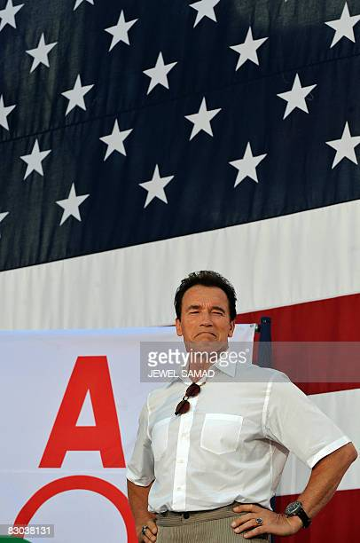 California Governor Arnold Schwarzenegger stands on a stage during a ceremony organized to honor California Olympians and Paralympians from the...