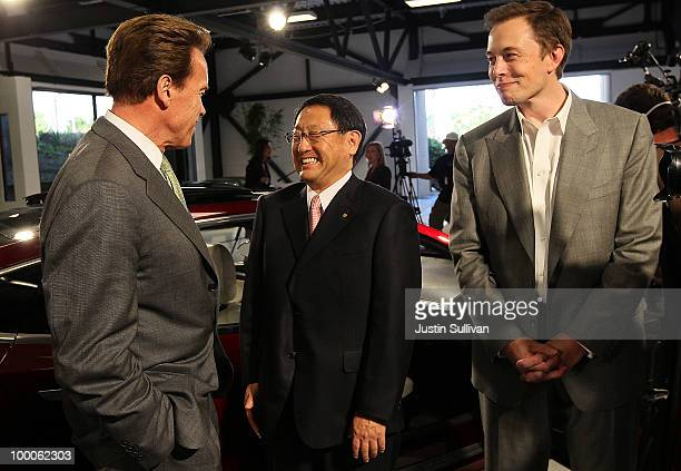 California governor Arnold Schwarzenegger Toyota CEO Akio Toyoda and Tesla Motors CEO Elon Musk chat before a news conference at Tesla Motors...