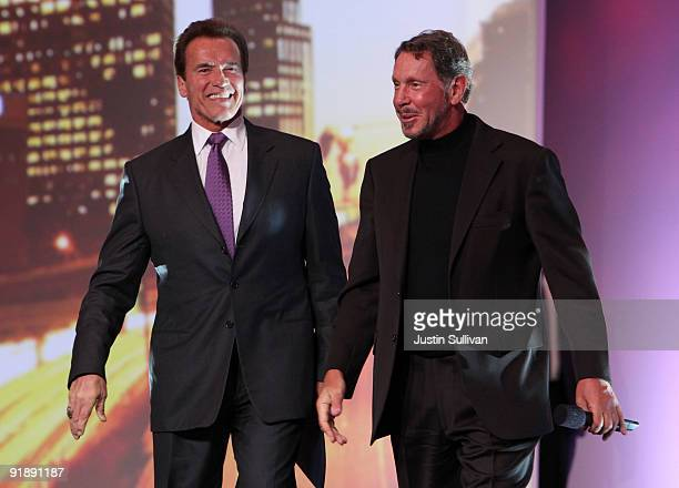 California governor Arnold Schwarzenegger walks onstage with Oracle CEO Larry Ellison at the 2009 Oracle Open World conference October 14 2009 in San...