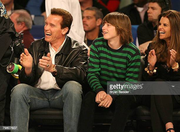 California governor Arnold Schwarzenegger with son Patrick Schwarzenegger watch during NBA AllStar Saturday Night part of 2008 NBA AllStar Weekend at...