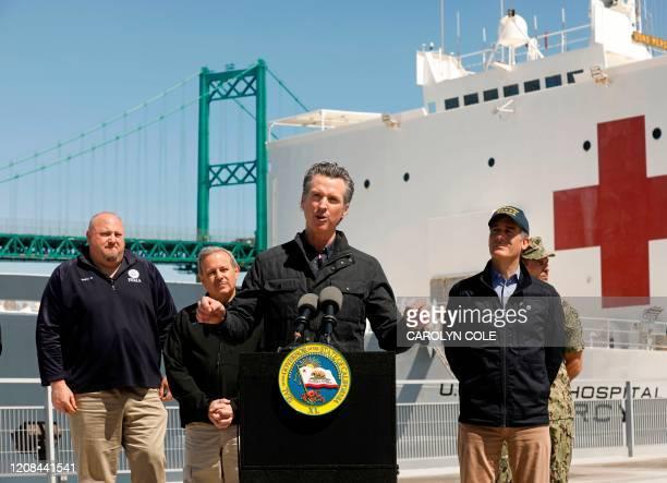 California Governor Gavin Newsom , flanked by Robert Fenton, FEMA Regional Administrator for Region 9, Director Mark Ghilarducci, Cal OES, and Los...