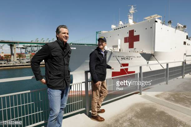 California Governor Gavin Newsom left and Los Angeles Mayor Eric Garcetti stand in front of the hospital ship USNS Mercy that arrived into the Port...