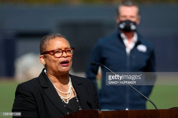 California Governor Gavin Newsom listens as San Diego County's Public Health Officer Dr. Wilma Wooten speaks to members of the media during a press...