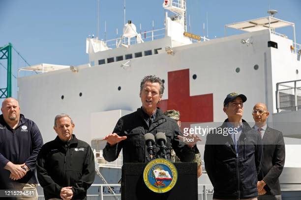 California Governor Gavin Newsom speaks in front of the hospital ship USNS Mercy that arrived into the Port of Los Angeles on Friday March 27 to...
