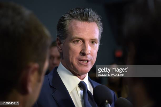 California Governor Gavin Newsom speaks to the press in the spin room after the sixth Democratic primary debate of the 2020 presidential campaign...