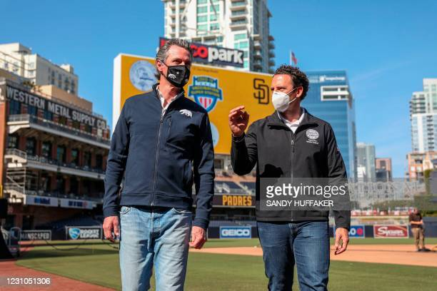 California Governor Gavin Newsom speaks with Supervisor Nathan Fletcher after a press conference at Petco Park, February 8, 2021 in San Diego,...